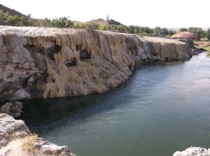 These travertine formations are topped by standing pools of water that is forced out of the ground by the hot springs.
