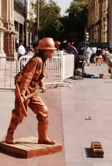 SEE THE GUY AGAINST THE FENCE, TOP RIGHT? HIS FOOT IS MISSING - THE COPPER DUDE ONLY STANDS STILL FOR MONEY.